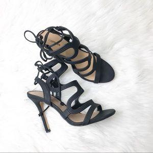 Black express swirl caged high heel sandals